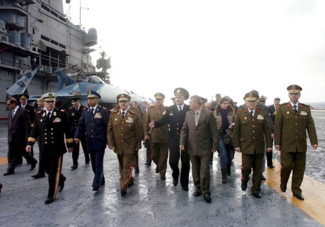 Russian Foreign Policy: Syria's Defense Minister General Dawood Rajiha visits the Russian aircraft carrier Kuznetsov in Tartous.