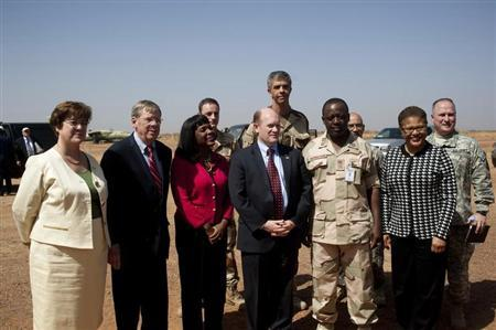Chris Coons and other US Politicians pose for a picture at a Malian air base where French soldiers are stationed.